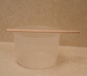 Plastic mixing cup/bowl and wooden spatula